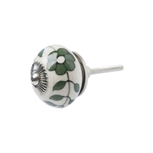 Knob with green decoration